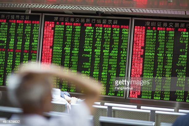 chinese citizens watching stock market, beijing 2015 - china politics stock pictures, royalty-free photos & images