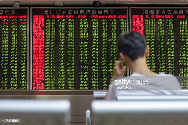 chinese citizens watching stock market, beijing 2015 - ticker tape stock pictures, royalty-free photos & images