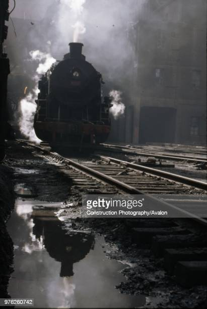 A Chinese Class PL2 industrial Prairie waits to draw a rake of Cauldron wagons containg molten steel from the blast furnaces at Anshan Iron Steel...