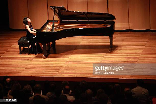 Chinese classical pianist Yuja Wang performs on stage during her evening solo piano recital featuring works by composers Rachmaninov Beethoven...