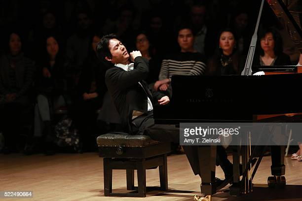 Chinese classical pianist Yundi finishes playing before receiving the audience after an all Chopin program which included the composer's 24 Preludes...