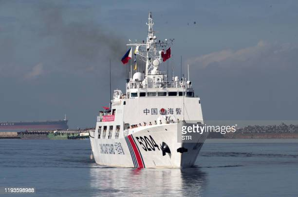 Chinese Coast Guard ship prespres to anchor at Manila port on January 14 for a port call. - Members of Chinese Coast Guard are in the Philippines to...