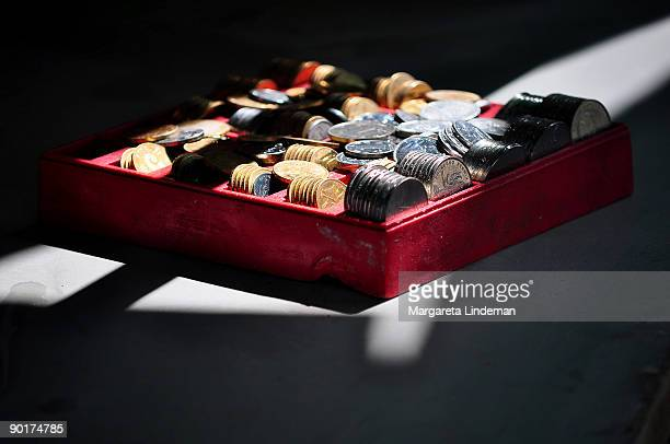Chinese coins in a red box captured in light