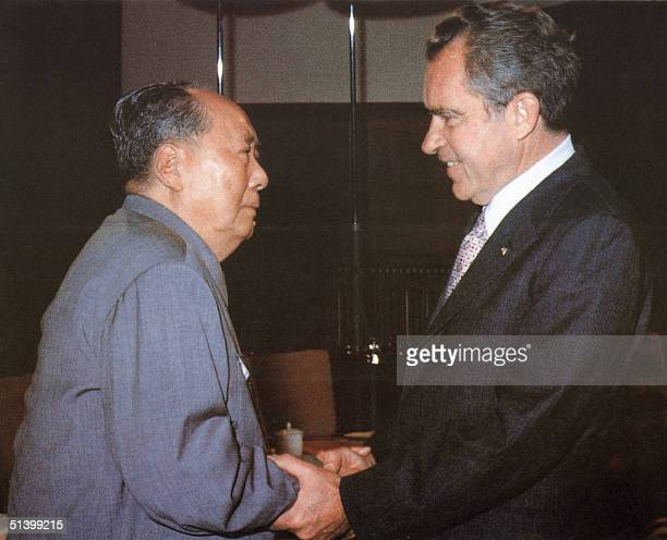 Chinese communist leader Chairman Mao Zedong welcomes US President Richard Nixon at his house in Beijing President Nixon urged China to join the...