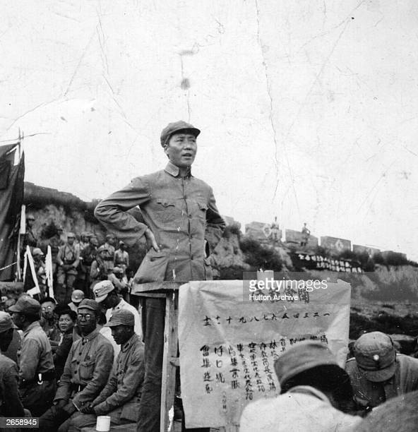 Chinese Communist leader Mao Zedong , better known as Mao Tse-tung, addresses a meeting calling for even greater efforts against the Japanese, at the...