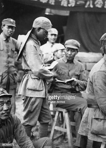 Chinese Communist Leader Mao Zedong signs an autograph for a student at the Kangdah cave university, 1938.