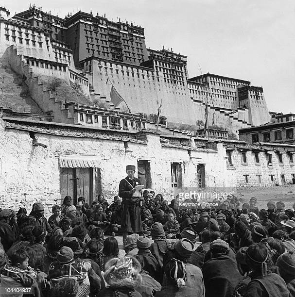 A chinese Communist leader reading a proclamation from Beijing to a crowd of Tibetans calling on them to give their allegiance to The PanchenLama...