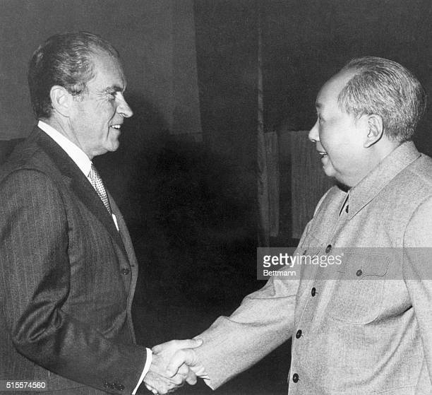 Chinese Communist Party Chairman Mao Tse-Tung greets Richard Nixon in a private meeting on February 21, 1972.