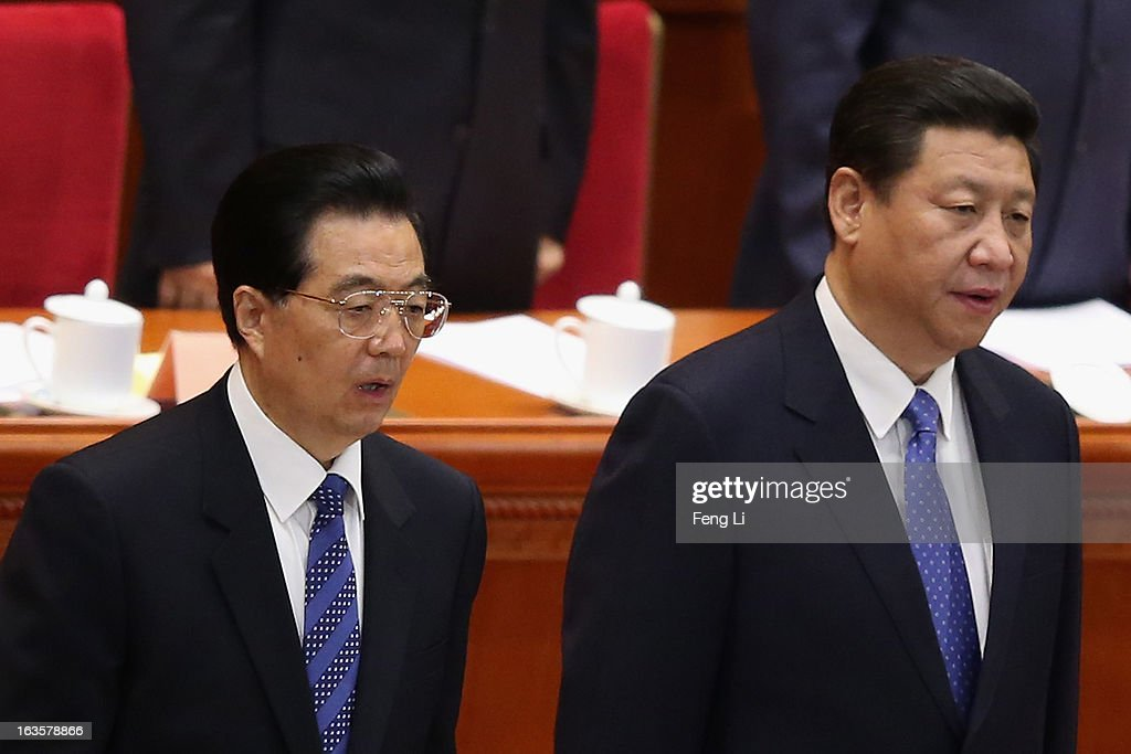 Chinese Communist Party chief and incoming-President Xi Jinping (R) and Chinese President Hu Jintao (L) stand for the national anthem during the closing session of the annual Chinese People's Political Consultative Conference (CPPCC) held at the Great Hall of the People on March 12, 2013 in Beijing, China. The newly-elected Chairman of the CPPCC Yu Zhengsheng pledged Tuesday that China will not copy Western political systems under any circumstances.