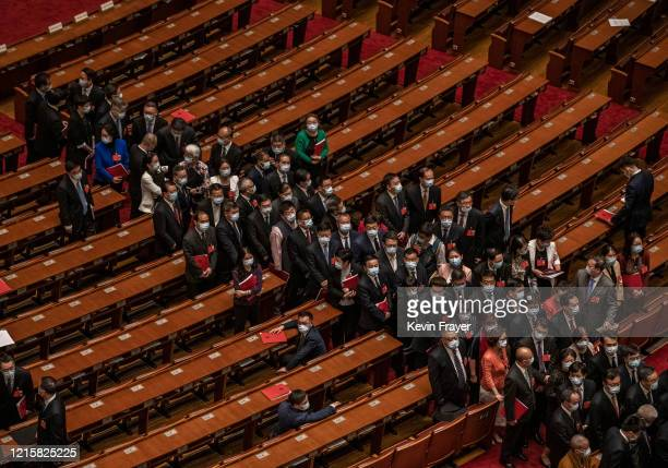 Chinese Communist Party delegates file out of the closing session of the National People's Congress at the Great Hall of the People on May 28 2020 in...
