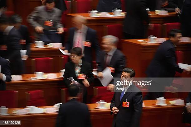 Chinese Communist Party General Secretary and incoming-President Xi Jinping leave after a plenary session of the National People's Congress at the...