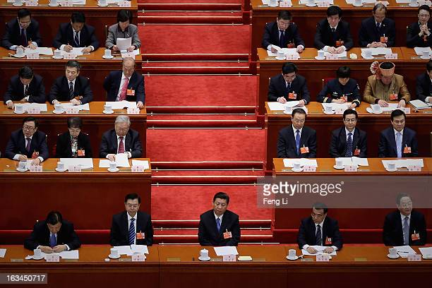 Chinese Communist Party General Secretary and incoming-President Xi Jinping , incoming-Chairman of the Standing Committee of the National People's...