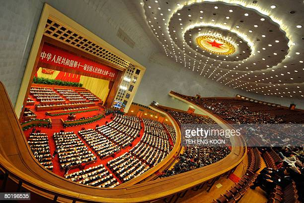 Chinese Communist Party members and delegates attending a plenary session of the National People's Congress at the Great Hall of the People in...