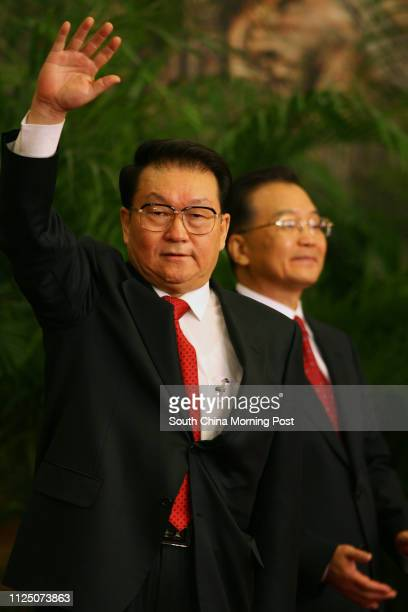 Chinese communist party's new leadership team Li Changchun waves to media at the Great Hall of the People in Beijing. 22 October 2007