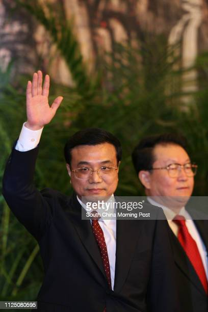 Chinese communist party's new leadership team Li Keqing waves to media at the Great Hall of the People in Beijing. And Li Changchun. 22 October 2007