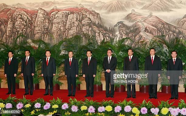 Chinese communist party's new leadership team Zhou Yongkang Li Keqing Li Changchun Wen Jiabao Hu Jintao Wu Bangguo Jia Qinglin Xi Jinping and He...
