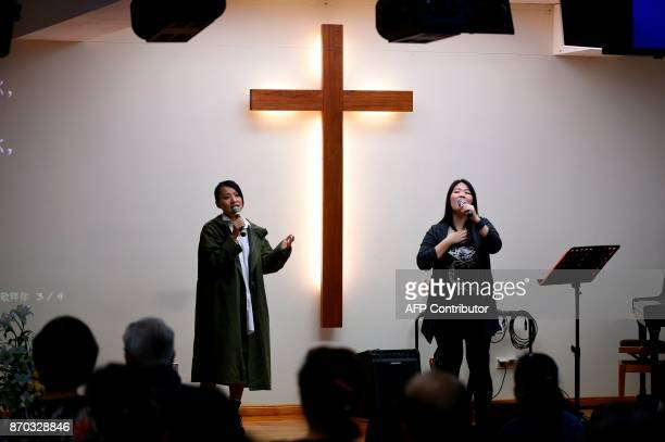 Chinese community members from Luxembourg sing during a Communion service on October 7 2017 in Luxembourg The Middle Kingdom its culture and its...