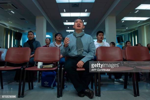 Chinese community members from Luxembourg take part in a Communion service on October 7 2017 in Luxembourg The Middle Kingdom its culture and its...