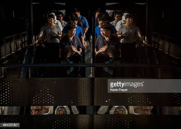 Chinese commuters exit the subway at a station on May 29 2014 in Beijing China Authorities have increased security in various public locations after...