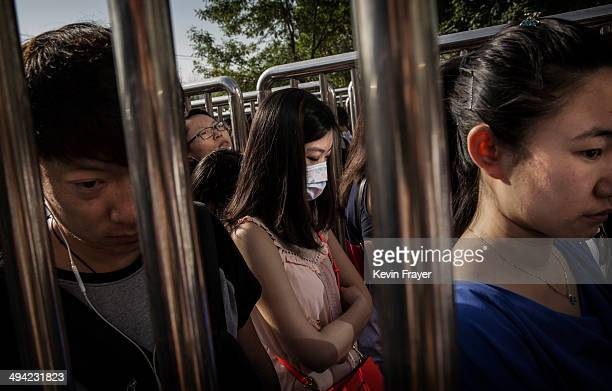 Chinese commuters lineup for a security check at a subway station on May 29 2014 in Beijing China Authorities have increased security in various...