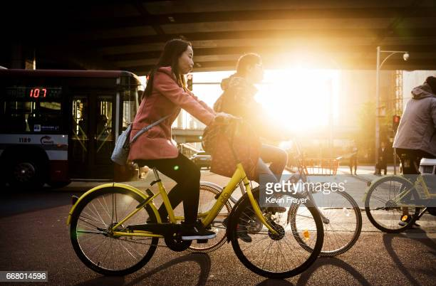 Chinese commuters ride shared bicycles during rush hour on April 12 2017 in Beijing China The popularity of bike shares has exploded in the past year...