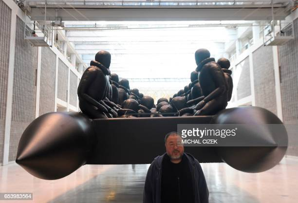 TOPSHOT CORRECTION Chinese conceptual artist and political activist Ai Weiwei poses for photographers during a press conference on his new exhibition...