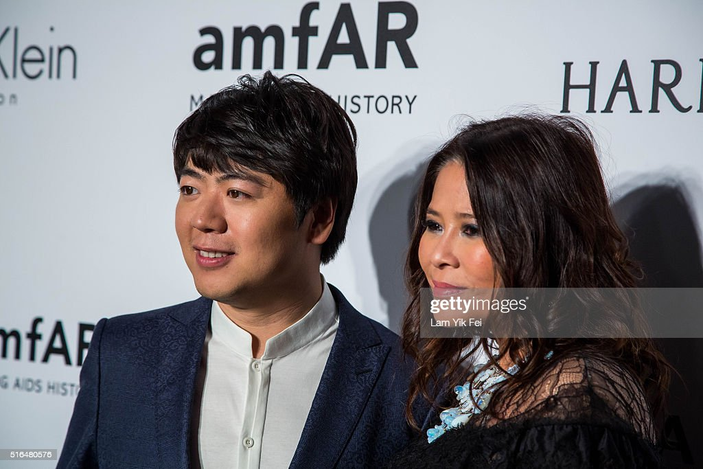 Chinese concert pianist, Lang Lang, attends the 2016 amfAR Hong Kong gala with a guest at Shaw Studios on March 19, 2016 in Hong Kong, Hong Kong.