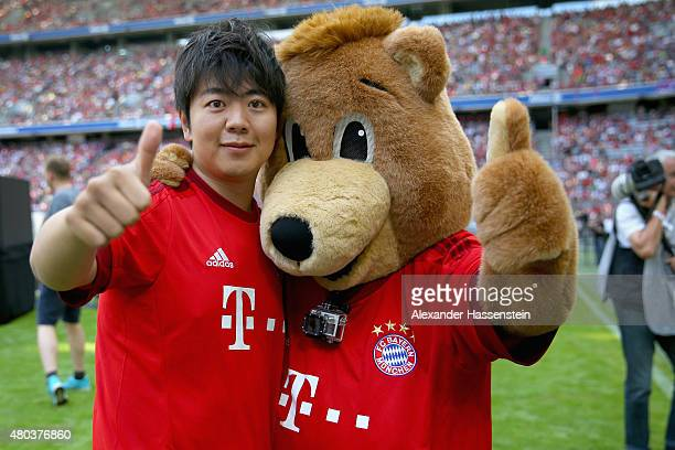 Chinese concert pianist Lang Lang poses with Bayern Muenchen mascot Bernie during the FC Bayern Muenchen season opening and team presentation at...