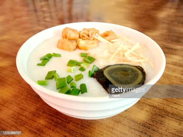 chinese congee or rice porridge - ポリッジ ストックフォトと画像