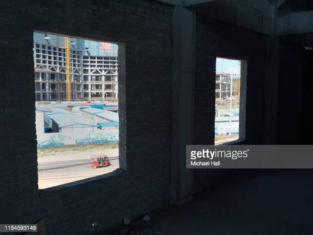 chinese construction site as seen through window cutouts - as stock pictures, royalty-free photos & images