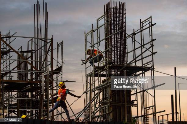 Chinese Construction workers head home after work on site at a new shopping mall called The Mall at One Galle Face which is part of the Chinese...