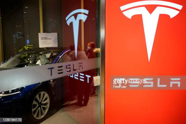 Chinese consumer look at a Tesla Model S electric car at the Tesla Store in a shopping mall on December 18, 2020 in Beijing, China.