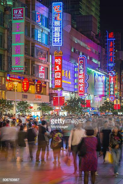 chinese consumers shopping on nanjing road neon lights shanghai china - shanghai billboard stock pictures, royalty-free photos & images