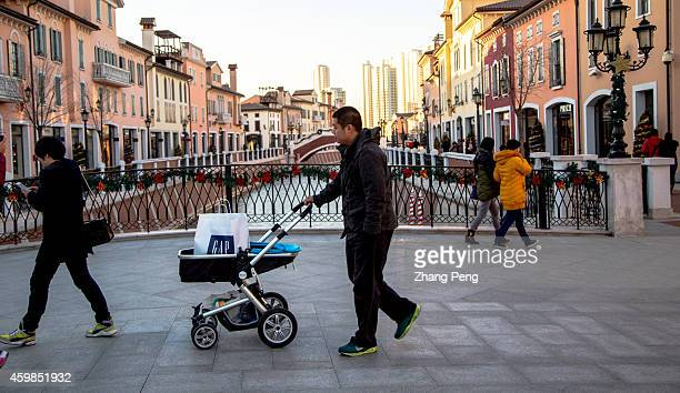 Chinese consumers walk on the bridge over the canal in Florentia Village The Florentia Village a replica of Italian town located in Wuqing an...