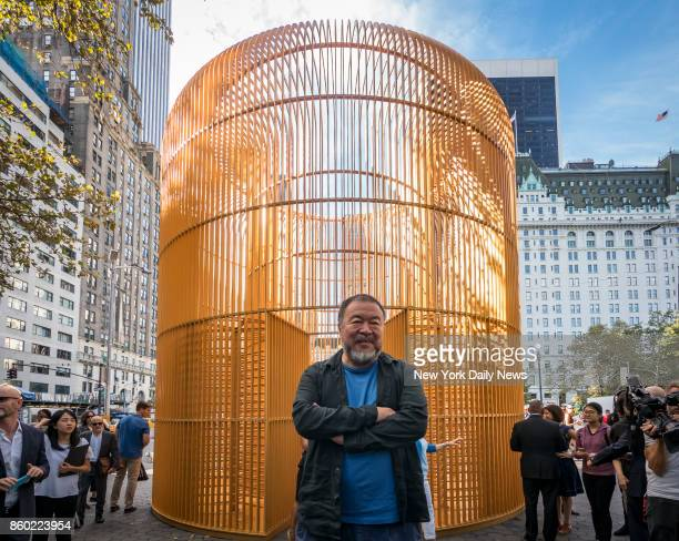 Chinese contemporary artist and activist Ai Weiwei poses for photos after the news conference concerning his instillation titled Good Fences Make...