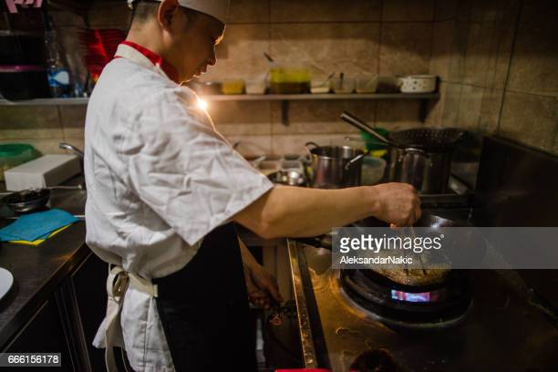 Chinese cook in action