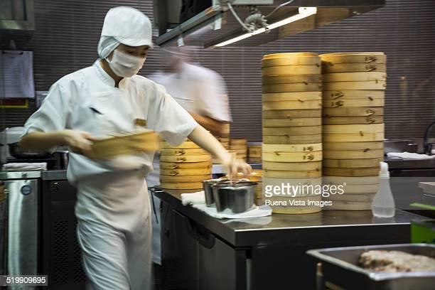 Chinese cook preparing dumplings