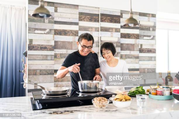 chinese couple cooking in the kitchen - asian food stock pictures, royalty-free photos & images