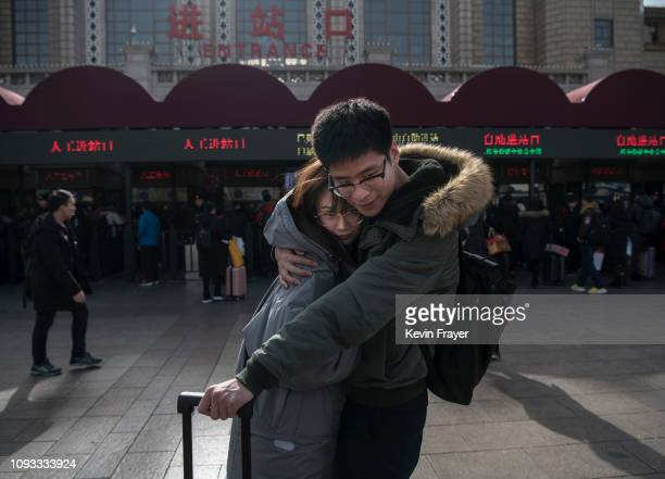 Chinese couple embrace before separating to visit family for the holiday at Beijing Railway Station on February 3 2019 in Beijing China Millions of...