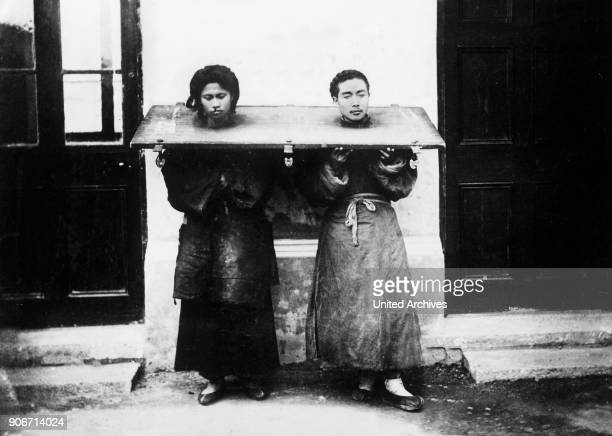 A Chinese couple in the pillory China 1910s