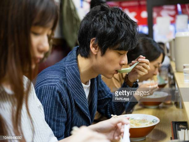 Chinese Couple on Vacation in Tokyo Japan Ramen Shop