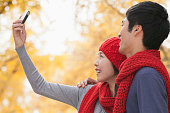 chinese couple taking selfportrait