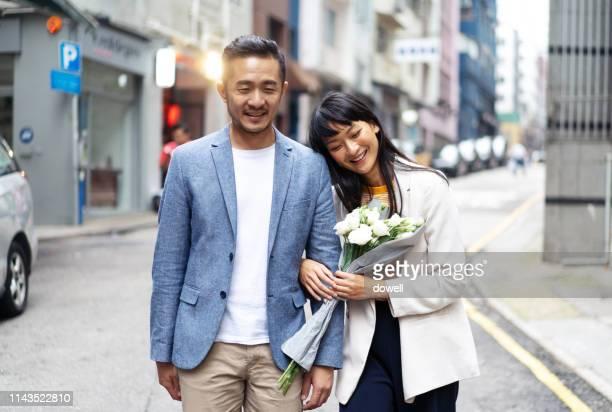 chinese couple walking at street in hong kong