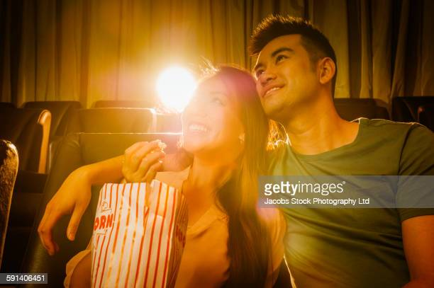 Chinese couple watching film in movie theater