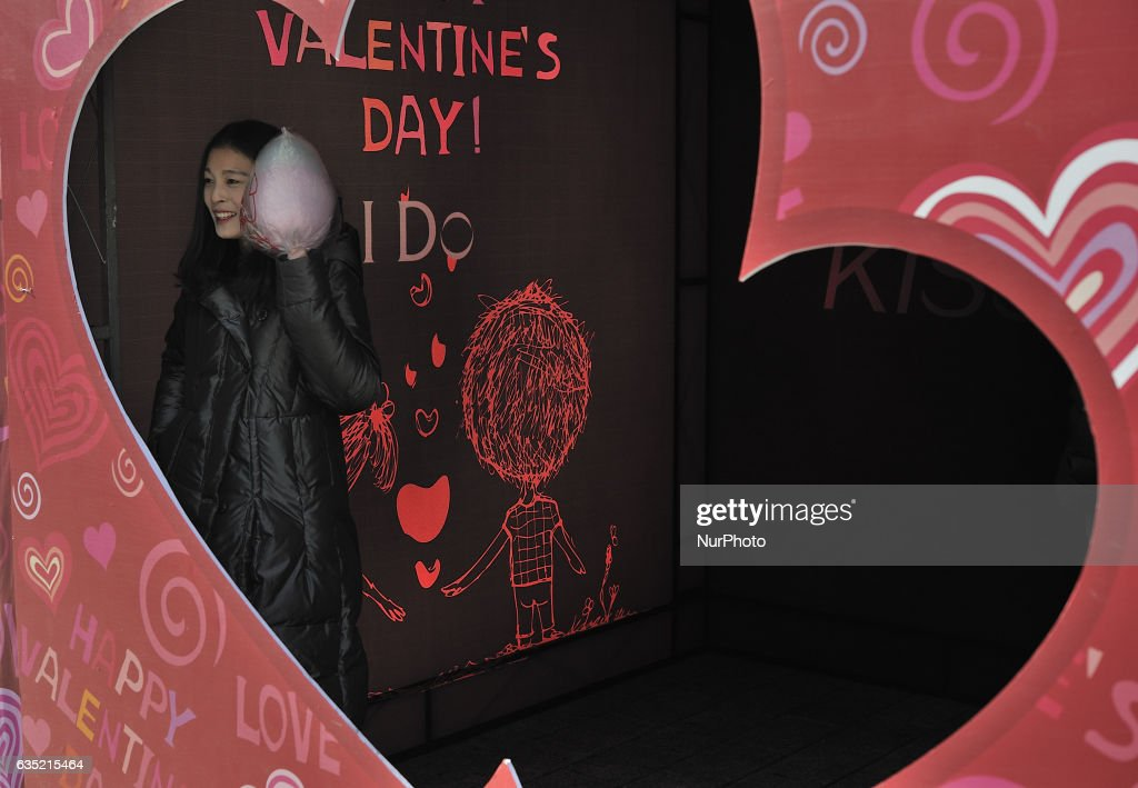 Chinese couples pose for photo during a symbolic ceremony on Valentine's Day at central street in Harbin city of China,14 February 2017. Many Chinese couples choose Valentine's Day to celebrate love as the western Valentine's Day becomes more and more popular among young people in China.