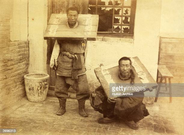 Chinese criminals are restrained in wooden stocks