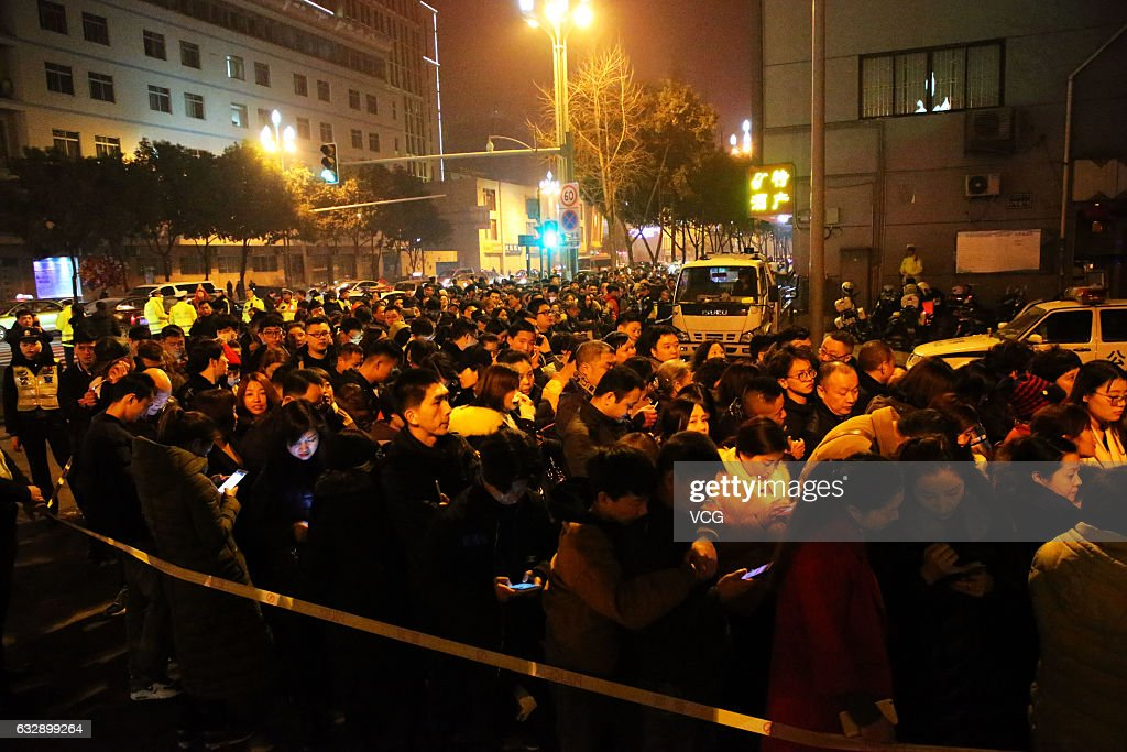 Chinese crowd to burn incense sticks to pray for good luck for the