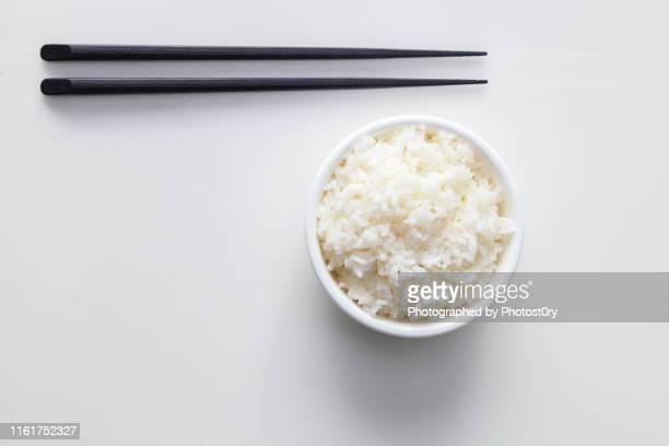 chinese culture - white rice & chopsticks - 米 ストックフォトと画像