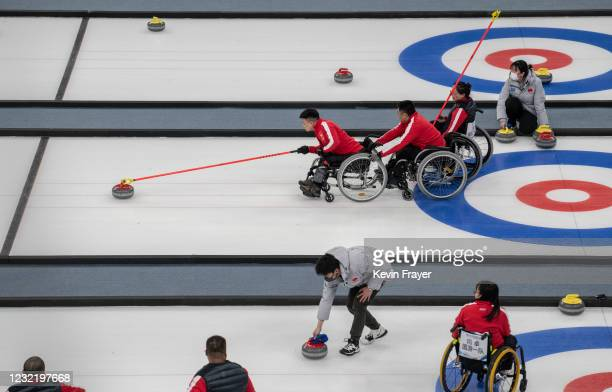 Chinese curler Zhang Ming Ling throws a rock during the whelelchair curling test event for the Beijing 2022 Winter Paralympics at the Ice Cube on...