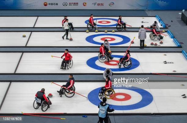 Chinese curlers play during the wheelchair curling test event for the Beijing 2022 Winter Paralympics at the Ice Cube on April 9, 2021 in Beijing,...